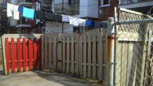Fences, laundry,yards,l;ane,Photograph by Neath Turcot